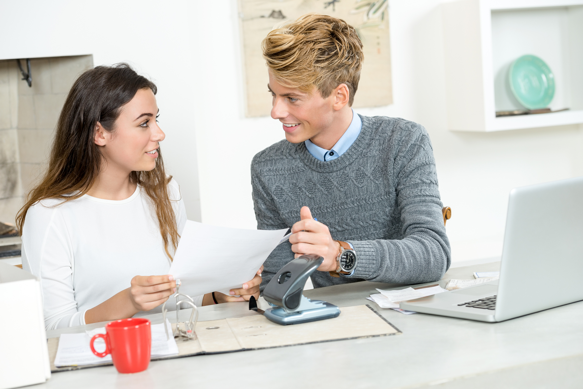Couple With Documents Calculating Finance At Home